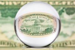 Esfera de cristal, dólar, uno Imagen de archivo