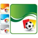 Esfera de futebol com os cartões vermelhos e amarelos Fotografia de Stock