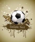 Esfera de futebol do futebol de Grunge que cai na terra Fotografia de Stock Royalty Free