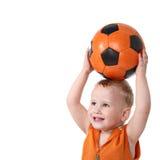 Esfera de futebol feliz da terra arrendada do miúdo Fotos de Stock Royalty Free