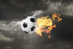 Esfera de futebol flamejante Fotografia de Stock