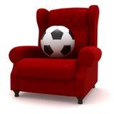 Esfera de futebol na cadeira fácil Fotografia de Stock Royalty Free