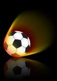 Esfera de futebol na flama Foto de Stock Royalty Free