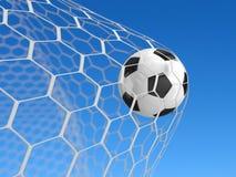 Esfera de futebol na rede Fotografia de Stock