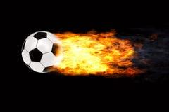 Esfera de futebol nas flamas Fotografia de Stock Royalty Free