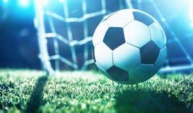 Esfera de futebol no campo do estádio Imagem de Stock Royalty Free