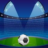 Esfera de futebol no estádio Foto de Stock Royalty Free