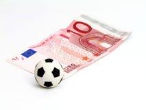 Esfera de futebol no euro da nota 10 Fotografia de Stock Royalty Free