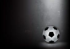 Esfera de futebol no fundo ondulado Imagens de Stock