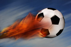 Esfera de futebol no incêndio Fotografia de Stock