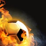 Esfera de futebol no incêndio Fotos de Stock Royalty Free