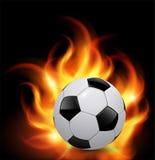 Esfera de futebol no incêndio Imagens de Stock