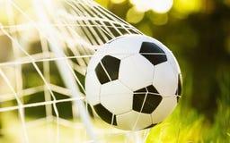 Esfera de futebol no objetivo Fotografia de Stock Royalty Free