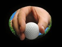 Esfera de golfe da terra arrendada da mão Fotografia de Stock