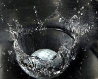 A esfera de golfe espirra Imagem de Stock