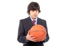 Esfera do basquetebol da terra arrendada do homem de negócio Imagens de Stock Royalty Free