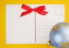 Esfera do cartão e do Natal foto de stock