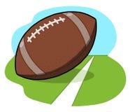 Esfera do futebol no campo Imagens de Stock