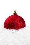 Esfera do Natal com neve Imagens de Stock