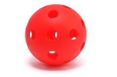 Esfera vermelha de Whiffle isolada no branco Imagens de Stock