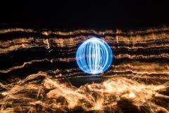 Esfera y fuego ligeros Fotografía de archivo libre de regalías