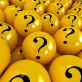 Esferas amarillas con los signos de interrogación Foto de archivo libre de regalías
