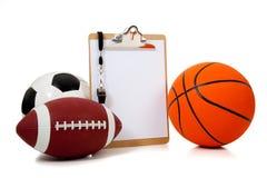 Esferas Assorted dos esportes com uma prancheta fotografia de stock royalty free