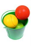 Esferas coloridas na cubeta Fotografia de Stock Royalty Free