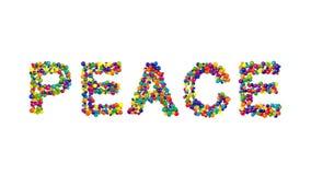 Esferas coloridas que forman la paz de la palabra Fotografía de archivo libre de regalías