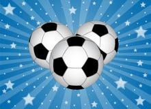 Esferas de futebol com estrelas Fotografia de Stock Royalty Free