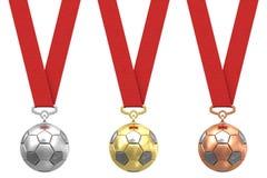Esferas de futebol com fitas vermelhas Fotos de Stock