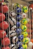 Esferas de futebol na loja Fotografia de Stock Royalty Free