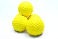 Esferas de golfe amarelas Imagens de Stock