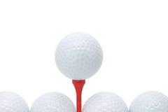 Esferas de golfe com T Fotografia de Stock Royalty Free