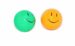 Esferas de golfe da face do sorriso foto de stock