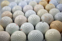 Esferas de golfe sujas Foto de Stock