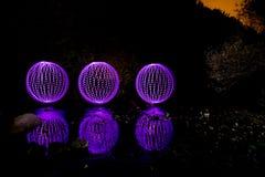 Esferas del color en el agua Fotos de archivo libres de regalías