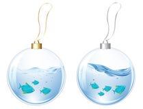 Esferas do ano novo com peixes azuis dentro Fotografia de Stock