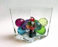 Esferas do banho em um recipiente, distorcido Fotos de Stock