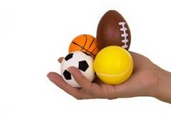 Esferas do esporte da terra arrendada da mão Imagem de Stock