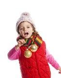 Esferas do Natal da terra arrendada da menina Imagem de Stock Royalty Free