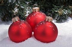 Esferas do Natal na neve Imagens de Stock Royalty Free