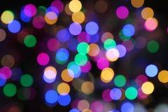 Esferas ligeras coloridas abstractas del día de fiesta de la Navidad Foto de archivo