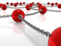 Esferas metálicas vermelhas conectadas pela corrente Fotografia de Stock