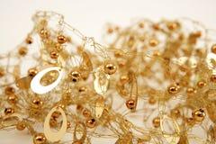 Esferas prendidas desarrumado e oval da textura da jóia dourada Imagens de Stock Royalty Free