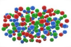 Esferas verdes y azules rojas en el cielo Imagen de archivo