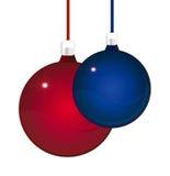 Esferas vermelhas e azuis lustrosas do Natal ilustração do vetor