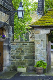 Esholt Village. The old school house and church gate in Esholt, near Bradford, in West Yorkshire, England. Esholt is the traditional filming location of the Royalty Free Stock Photo