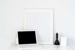 Esk office notebook with a picture frame. Desk office notebook with a picture frame on the table royalty free stock photos