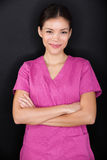 Żeńskiego pielęgniarka portreta szczęśliwy ufny, różowy i Zdjęcie Royalty Free